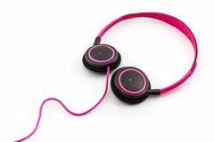 Écouteurs roses Photos stock