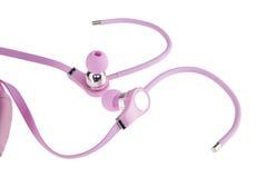 Écouteurs roses d'isolement sur un fond blanc photos libres de droits