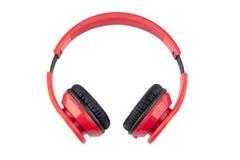 Écouteurs rouges d'isolat avec pading noir Photos stock