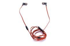 Écouteurs rouges d'isolement sur le blanc Photos libres de droits