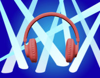 Écouteurs rouges sur le projecteur bleu Photographie stock