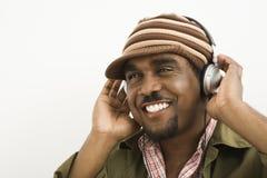 Écouteurs s'usants d'homme. Images libres de droits