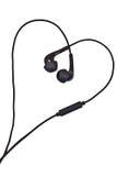 Écouteurs sonores dans la forme du coeur photos libres de droits