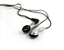 Écouteurs sur le blanc Image libre de droits