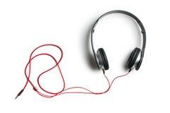 Écouteurs sur le fond blanc Photographie stock