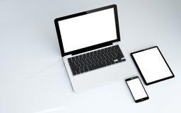 écran de blanc de comprimé, d'ordinateur portable et de smartphone Photos libres de droits