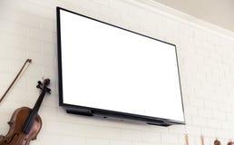 Écran de TV sur le mur blanc Photographie stock
