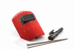 Écran protecteur et tige-support rouges avec le wir d'électrodes de soudure Photographie stock