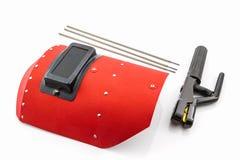 Écran protecteur et tige-support rouges avec le wir d'électrodes de soudure Photos libres de droits