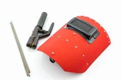 Écran protecteur et tige-support rouges avec le wir d'électrodes de soudure Photo libre de droits