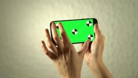 ?cran vert du smartphone banque de vidéos