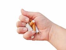 Écrasement des cigarettes Photos stock