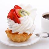 Écrimage de crème et de fraises Photographie stock