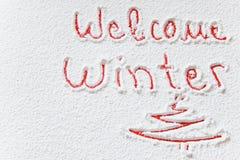 ` Écrit d'hiver d'accueil de ` sur la neige images libres de droits