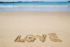 Écrit dans le sable sur la plage Photo libre de droits