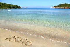 2016 écrit la plage sablonneuse Photos libres de droits