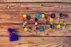 2016 écrit par des boutons et des perles Photos stock