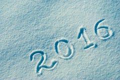 2016 écrit sur une neige Photographie stock libre de droits