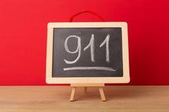 911 écrits sur le tableau noir d'école Photos libres de droits