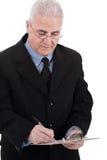 Écriture aînée confiante d'homme d'affaires en fonction Images stock