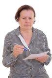 Écriture aînée triste de femme Photographie stock libre de droits