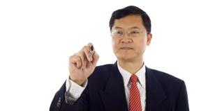 Écriture asiatique d'homme d'affaires Photographie stock libre de droits
