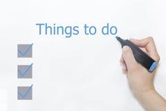 Écriture bleue 'choses de marqueur à faire' Images stock