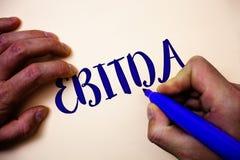 Écriture conceptuelle de main montrant Ebitda La photo d'affaires présentant des revenus avant intérêt impose l'amortissement Abb photographie stock