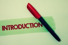 Écriture conceptuelle de main montrant l'introduction Pièce de présentation de photo d'affaires première d'une présentation forme photographie stock libre de droits
