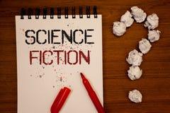 Écriture conceptuelle de main montrant la science-fiction Avènement fantastique futuriste de présentation de genre de divertissem image libre de droits