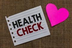 Écriture conceptuelle de main montrant le contrôle de santé Le bien-être d'examen médical des textes de photo d'affaires et l'ins photo stock