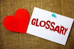 Écriture conceptuelle de main montrant le glossaire Liste des textes de photo d'affaires de termes alphabétique avec des descript Photographie stock