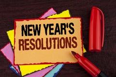 Écriture conceptuelle de main montrant les résolutions des nouvelles années Les objectifs de présentation de buts de photo d'affa Image libre de droits
