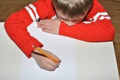 Écriture d'enfant avec le crayon Image stock