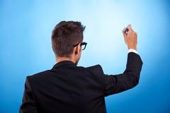 Écriture d'homme d'affaires avec le repère photo libre de droits