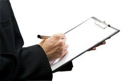 Écriture d'homme d'affaires dans la planchette, d'isolement Photo stock