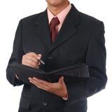 Écriture d'homme d'affaires pour l'ordre image stock