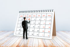 Écriture d'homme dans le calendrier Photo libre de droits