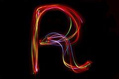 Écriture de ` du ` R de Word de lumière Image libre de droits