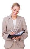 Écriture de femme d'affaires Photos stock