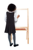 Écriture de fille d'école sur le conseil blanc photos libres de droits