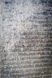 Écriture de Khmer sur le mur Photographie stock libre de droits