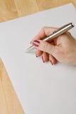 Écriture de la main de la femme Photos stock