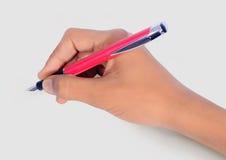Écriture de main avec le stylo d'isolement photos libres de droits