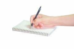 Écriture de main avec le stylo sur le papier Images stock
