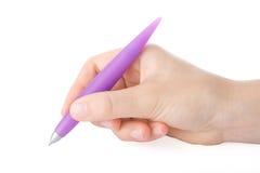 Écriture de main avec un crayon lecteur image libre de droits