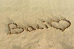 Écriture de plage de Bali en sable Image stock