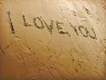 Écriture de sable d'amour Photographie stock libre de droits