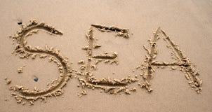 Écriture de sable - MER Images libres de droits