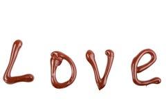Écriture et peinture avec du chocolat - amour Photo stock